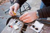 Working Hands Repairing Bicycle Puncture poster