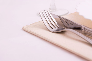 table knife and fork over plate
