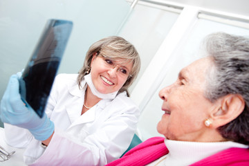 Dentist with an elder patient
