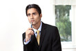 Young businessman thinking serious expression