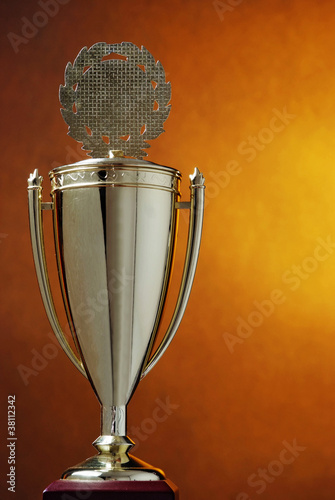 Trophy cup on orange background