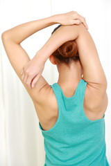 young woman doing stretch