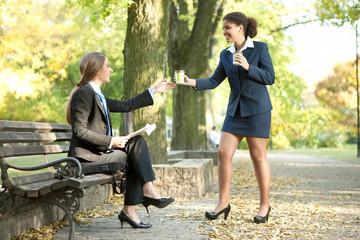 businesswomen together on break