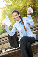 happy businesswoman with documents