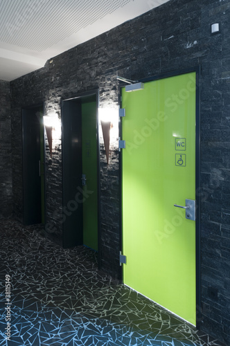 toilet door made of plexi glass in a swimming pool