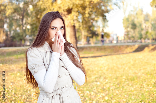 girl with tissue having flu or allergy