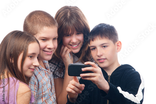 Teenage boy showing digital content on his mobile phone