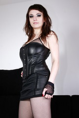 Gothic girl in leather all in black