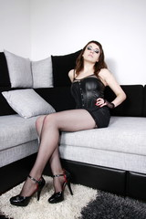 Gothic girl sitting on couch with nice stockings