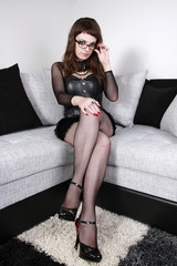 Gothic girl sitting on couch