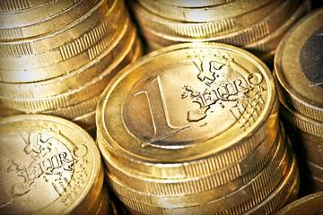 Columns of one euro coins. Selective focus.