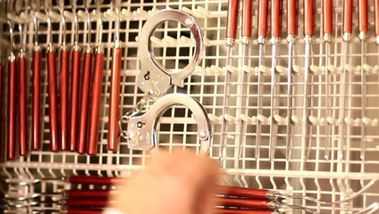 Dishwasher with Handcuffs - taking from appliance - top view