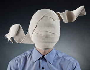 Portrait of the man with elastic bandage on a head