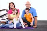 Fototapety Youn family in sport center