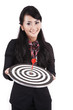 Beautidul businesswoman holding a dartboard
