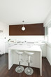 Modern kitchen with brown wall above the counter