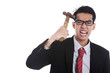 Mad businessman hit his head with hammer