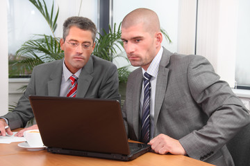 Two businessmen working together on a project