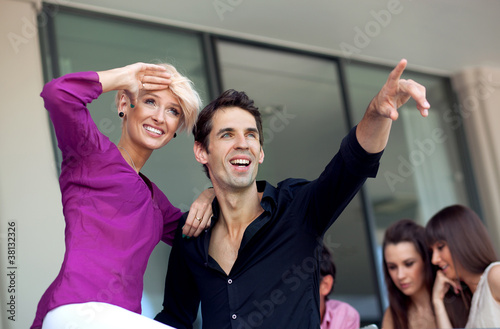 Beautiful couple pointing at something