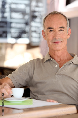 Senior man drinking a cup of expresso