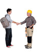 Old and young student worker shaking hands