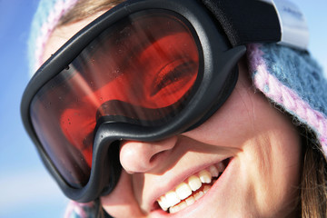 Closeup of a woman wearing a ski mask