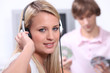 Teenagers listening to music on headphones