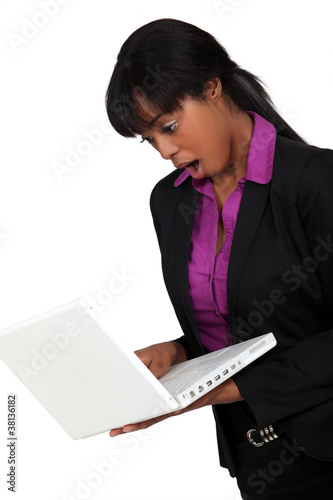 businesswoman looking very surprised her laptop