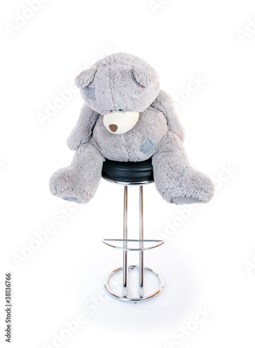 teddy bear sitting on a chair. isolated