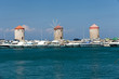 Medieval windmills at Mandraki Harbour in  Rhodes,