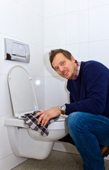 Man cleaning toilet