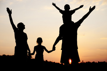 Silhouette, happy children with mother and father,