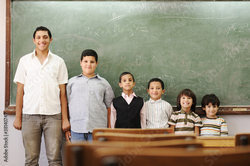 Children in school, from kindergarten, to college boy