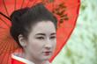 Geisha with red umbrella