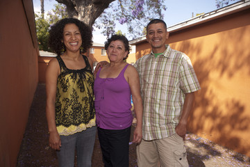 Portrait of mature woman standing with her son and daughter-in-law