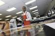 Manual worker looking down at prints