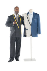 Portrait of tailor standing with mannequin