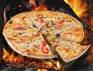 Pizza en horno de leña.