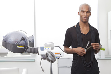 Portrait of African male hairdresser