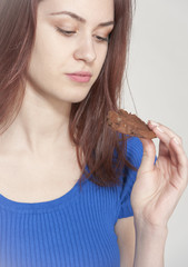 Young woman holding a cookie