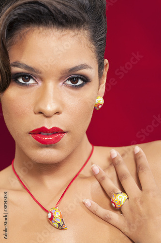Portrait of a sensuous woman wearing ring and a neck piece