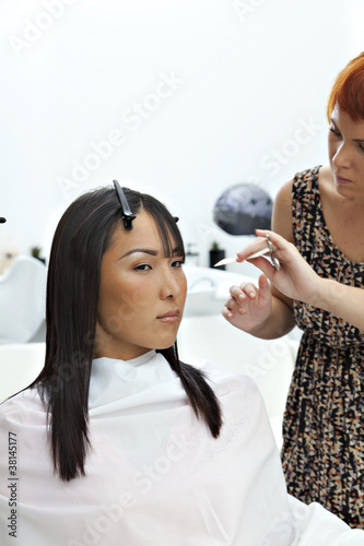 Woman getting herself a new hair style at beauty salon