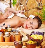 Fototapety Woman getting thai herbal compress massage .