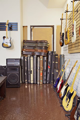 Electric guitars with guitar cases and amplifier in store
