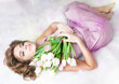 Alluring gentle young woman with bouquet of fresh flowers