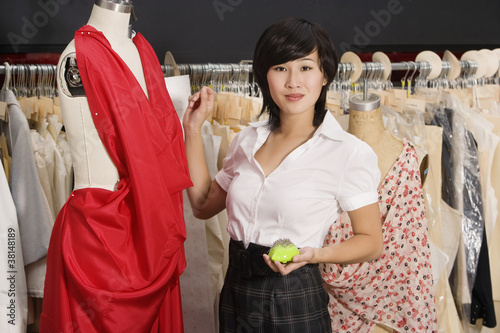 Young woman standing near the mannequin