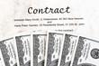 Dollar Geldscheine und englischer Vertrag