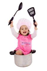 enfant avec ustensiles de cuisine et chapeau de chef