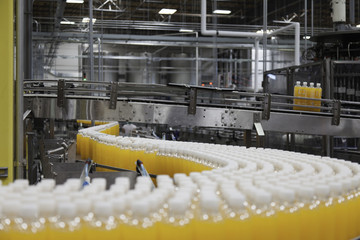 Orange juice bottles on production line
