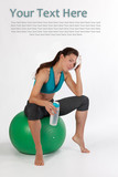 Athletic woman sitting on fit ball
